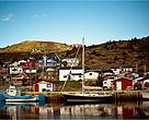 Petty Harbour, Newfoundland, houses and boats line the water in the harbour.