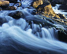 The Cameron River flows over rocks in the Northwest Territories, Canada.